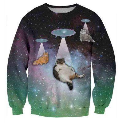 Foute trui met groene galaxyprint en katten die opgezogen worden door ufos